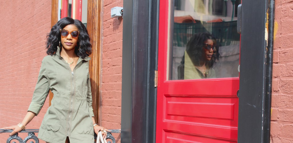 green trench coat, military jacket, taupe OTK boots, cream purse, brown and gold sunglasses
