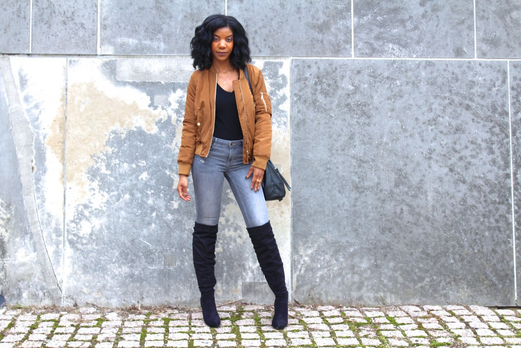 coffee bomber jacket,gray jeans,gray ripper jeans, black otk boots, black purse
