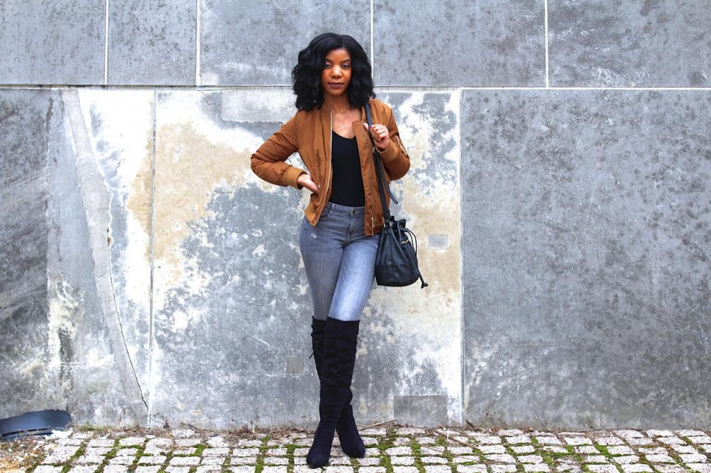 coffee bomber jacket,gray jeans,gray ripper jeans, black otk boots, black purse