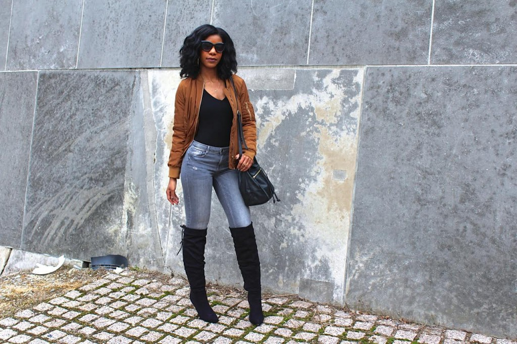 coffee bomber jacket,gray jeans,gray ripper jeans, black otk boots, black purse, black sunglasses