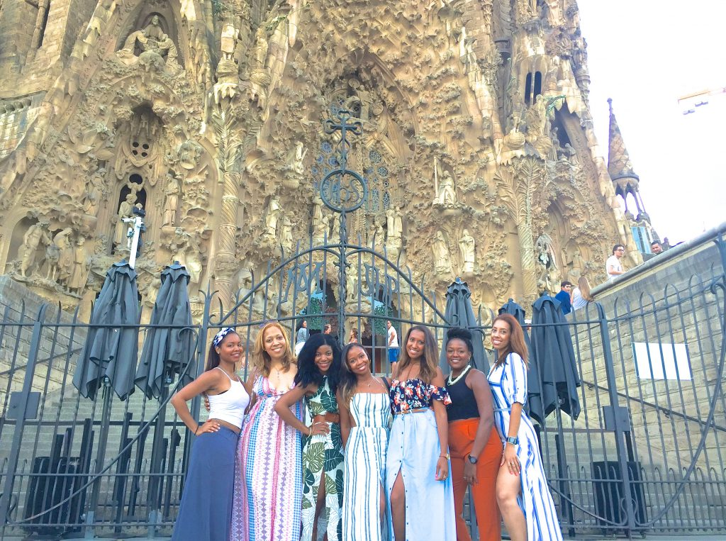 boohoo palm leaf print m slit maxi dress, tan waist belt, tan knee high gladiator sandals, Barcelona, Cathedral, Spain, group picture, black girls travel, travel noire