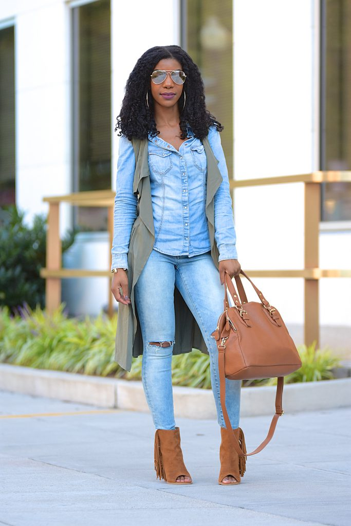 Denim shirt, Ripped denim jeans, olive green longline vest, tan peep toe fringe booties, tan doctor's bag, Canadian tuxedo