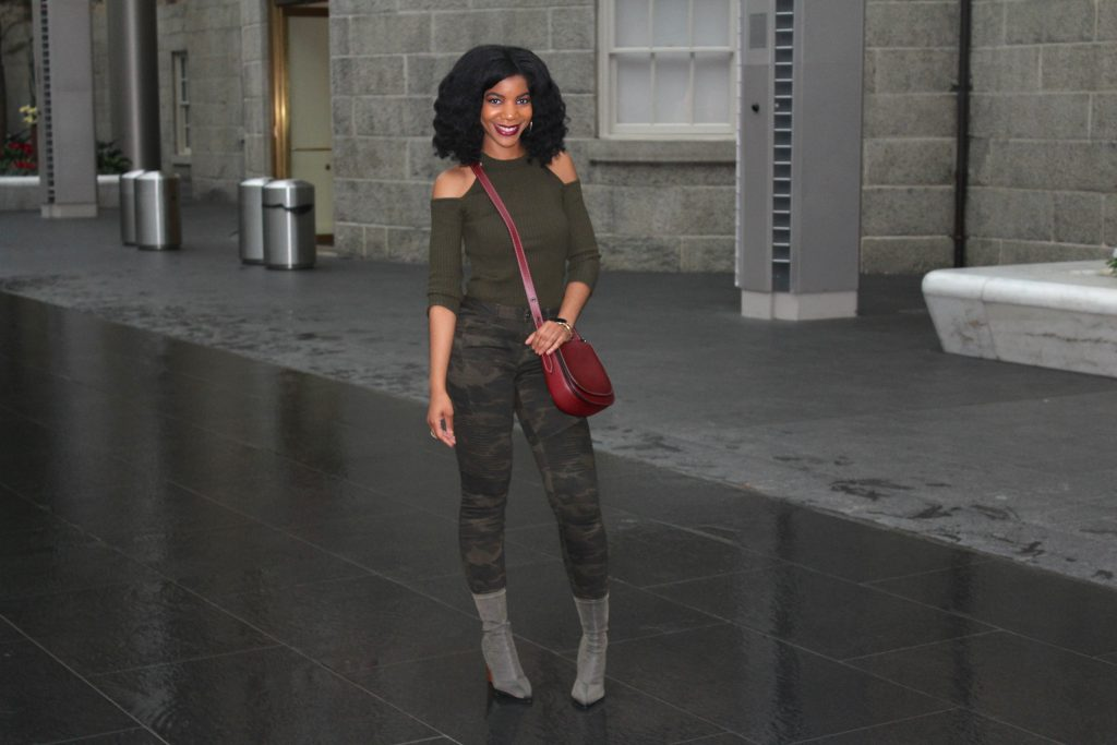 Monochrome Khaki Green Outfit, Burgundy Coach Saddlebag, Khaki Green Cold Shoulder Sweater, Green Camo Pants, Green Lycra Sock Boots, Black Vegan Leather Jacket, Coach 75th Anniversary