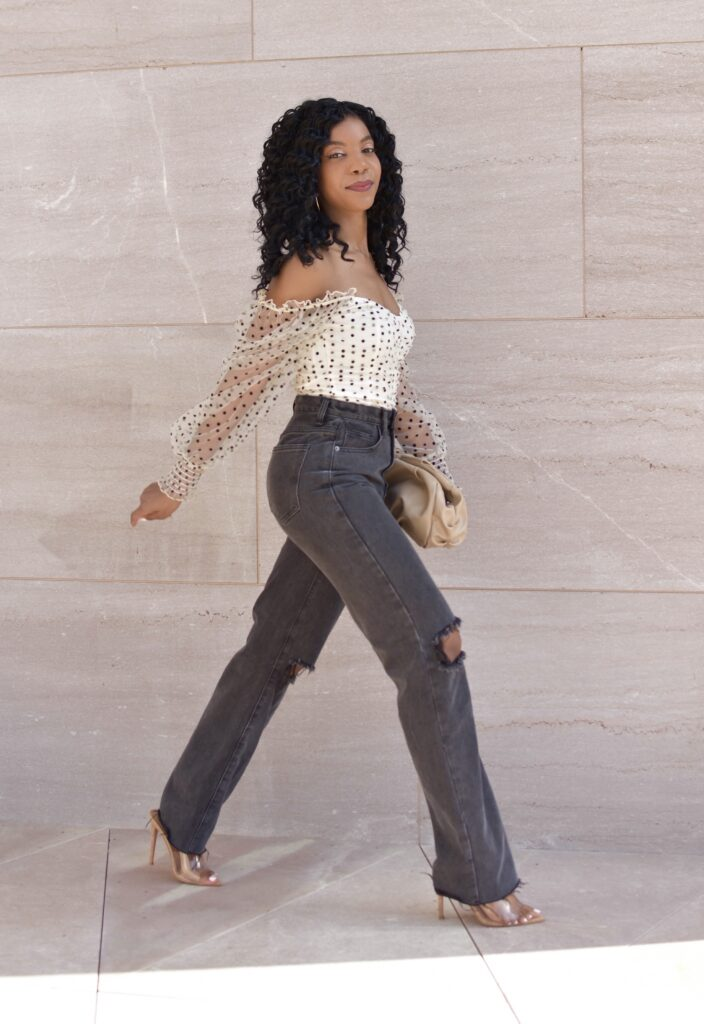 SHEIN Flocked Polka Dot Ruched Mesh Bodysuit, Missy Empire Gray Wide Leg Busted Knee Jeans, Ego Clear Heels, Asos Design Ruched Clutch, fall fashion, fall outfit, fall accessories, brunch outfit idea, date outfit idea, neutral outfit idea, going out outfit, vacation outfit, black women's style, black blogger, holiday outfit, winter outfit, curly crotchet protective hairstyle